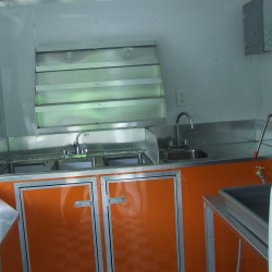 (#1006) Interior Shaved Ice Trailer, Orange Cabinets and Flavor Racks